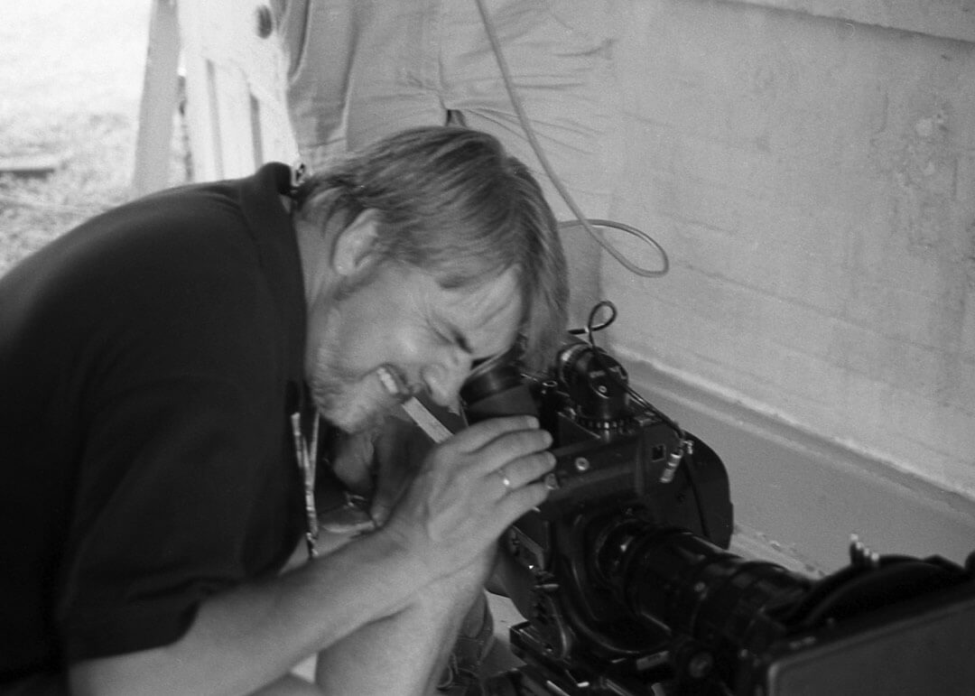 Alan Goodson Creative Director looking through camera lens