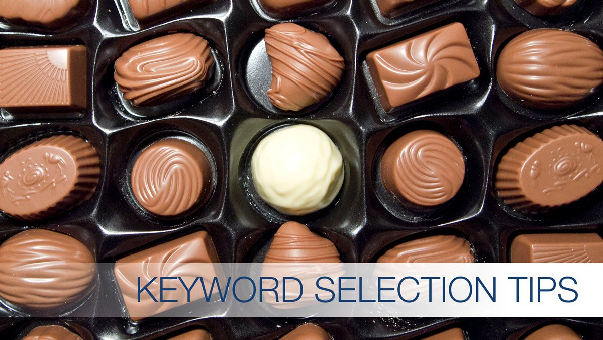 SEO Keywords and a half empty box of chocolate candy
