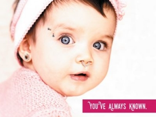 Baby with face nose ring, eyebrow bar, and ear guage. Headline: You've always known.