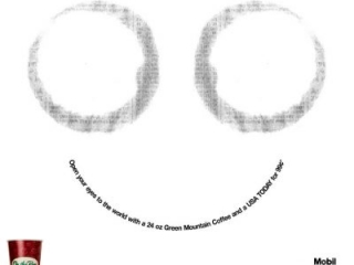 Two coffee cup stains (looks like eyes). Headline (in shape of a smile): Open your eyes to the world with a 24 oz Green Mountain Coffee and a USA TODAY for 99¢