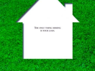 Shape of house cut out of grass. Headline: The only thing missing is your loan.